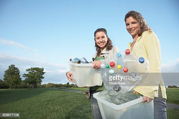 Women with Recycling Bins