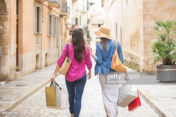 women with shopping bags on street, palma de mallorca, spain - palma majorca stock photos and pictures
