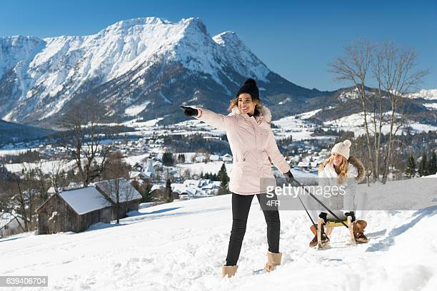 Women with sled outdoor in the Snow, Austrian Alps