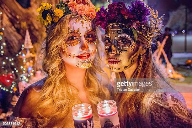 Women with sugar skull makeup at Dia de los Muertos procession