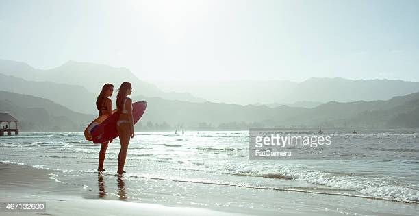 Women with Surfboards at the Beach