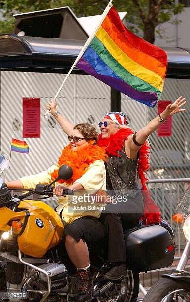 Women with the 'Dykes on Bikes' group ride in the 32nd annual San Francisco Gay Pride Parade June 30 2002 in San Francisco California