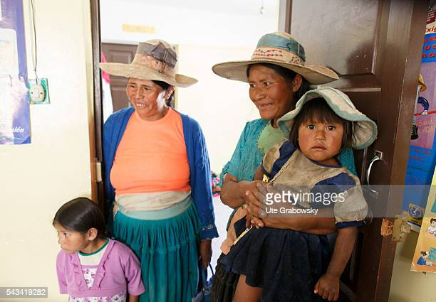 Women with their children in a health center in a small village in the Andes on April 23 2016 in Tawarchapi Bolivia