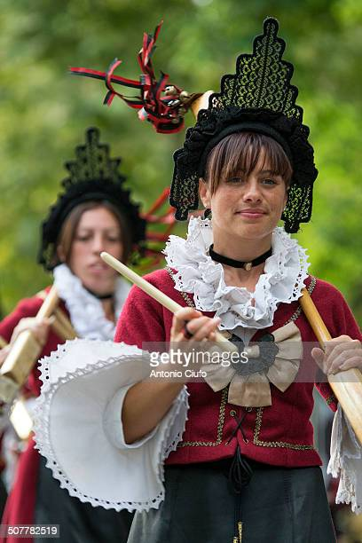 CONTENT] Women with typical dress of the Val d'Aosta during religious festival 'Sagra delle Regne'