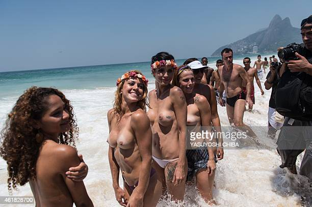 Women without their bikini tops protest against a ban on topless at Ipanema beach in Rio de Janeiro Brazil on January 20 2015 AFP PHOTO / YASUYOSHI...
