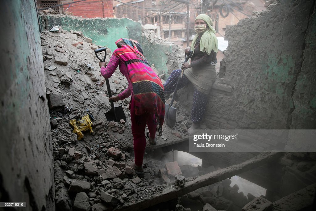 Women work at a construction site in Bhaktapur on April 23, 2016 in Kathmandu, Nepal. The 7.8-magnitude earthquake struck Nepal close to midday on April 25 last year, killing an estimated 9,000 people. Reports suggest the government promised 2,000USD to affected households but has only paid out a fraction of the amount so far and an estimated 660,000 families are still living in sub-standard temporary shelter or unsafe accommodations one year later.