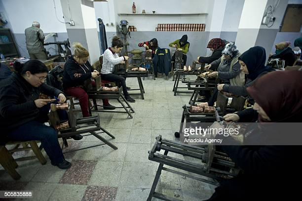 Women work at a copperworking workshop in Gaziantep Turkey on January 20 2016 Copperworking which shrunk dramatically due to low demand in the early...