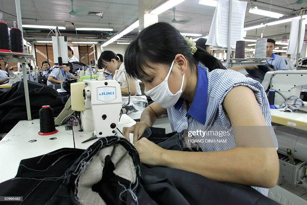 STORY 'VIETNAM-CHINA-US-EU-TRADE-TEXTILES' Women work at a