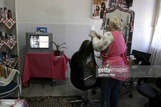 Women work in a hairdressing program at the only female prison in Romania December 15 2006 in Targsor Romania The prison with inmates from 17 to the...