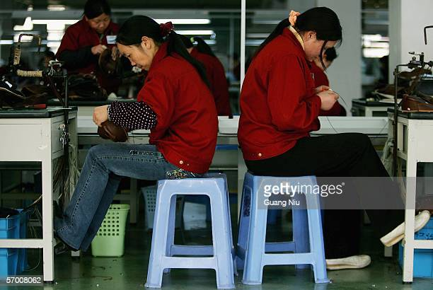 Women work on a production line at a leather shoe factory on March 3 2006 in Wenzhou of Zhejiang Province China Wenzhou is one of the major shoe...