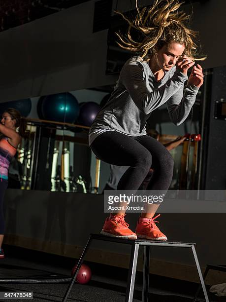 Women work out in fitness gym, indoors
