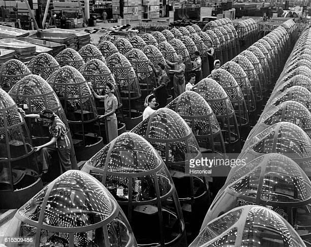 Women workers check the new transparent noses of A20 attack bombers at Douglas Aircraft's Long Beach California plant