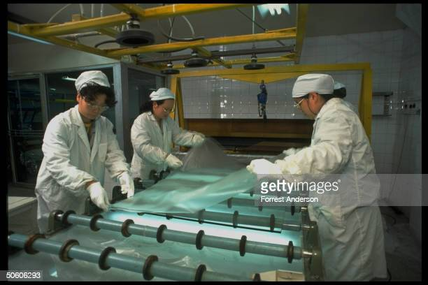 Women workers making bullet proof glass at Fu Hua Glass Co Ltd plant mfg automotive glass in joint venture w USbased Ford Motor