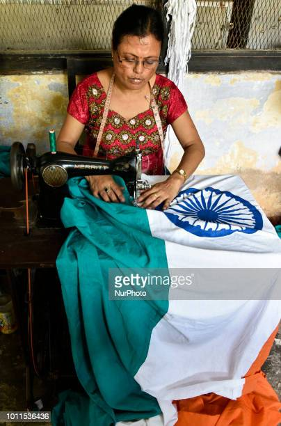 Women workers sew a national flag ahead of the Independence Day at Assam Khadi amp Village Industries Board in Guwahati Assam India on 5 August 2018...