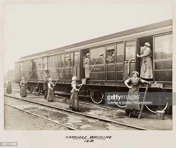 Women workers washing a railway carriage at Doncaster carriage works Railways employed far fewer women than men usually in low paid jobs in cleaning...