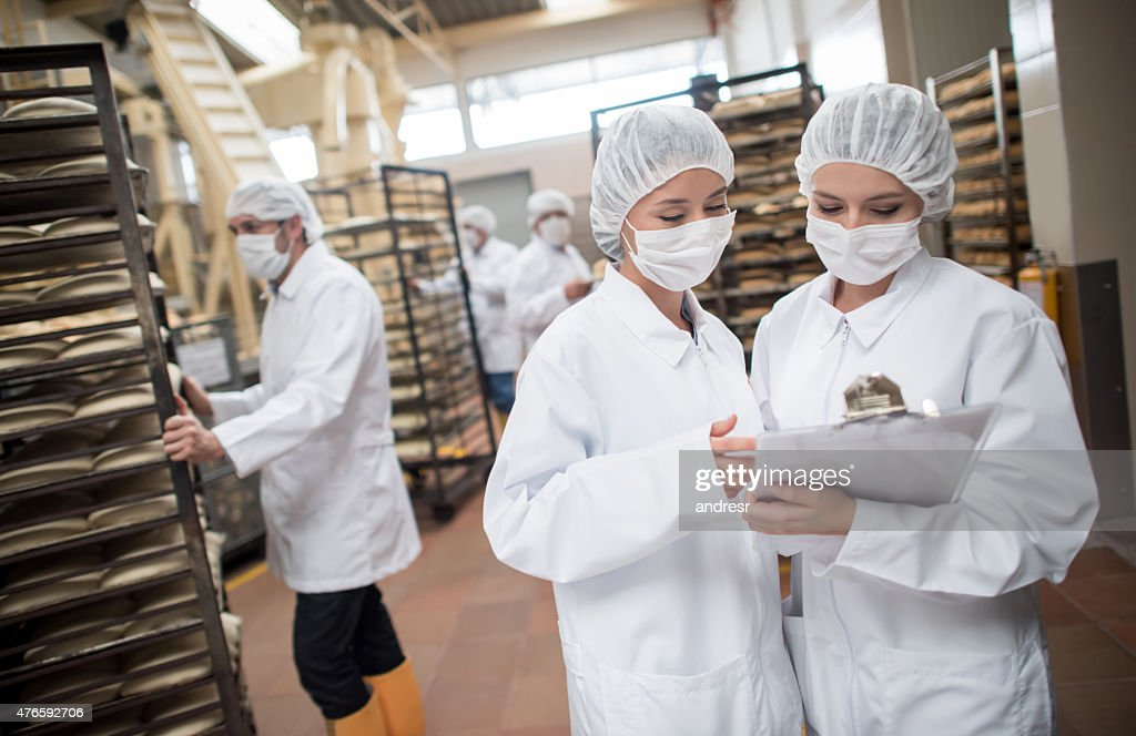 Women working at a food factory : Stock Photo