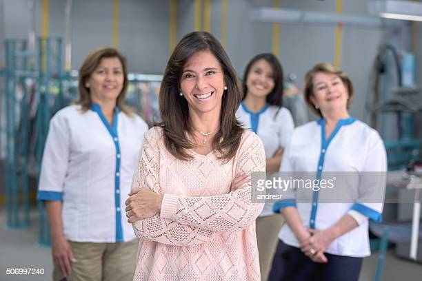 women working at a laundry service - commercial cleaning stock photos and pictures