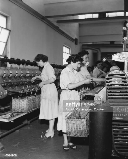 Women working at a Marzotto textile factory in Portogruaro Venice province Italy circa 1955