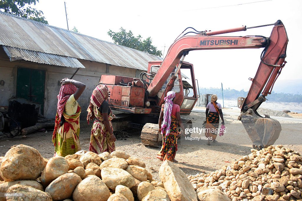 Women working at a stone crushing site : News Photo