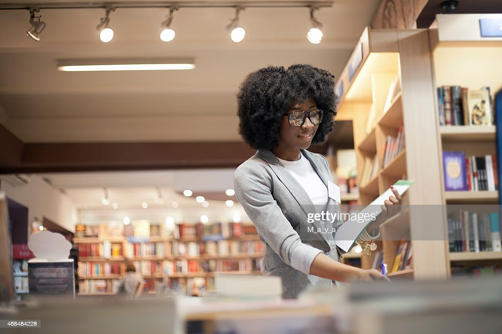 Women working at bookstore : Stock Photo