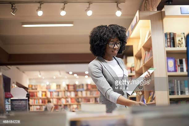 women working at bookstore - bookstore stock pictures, royalty-free photos & images