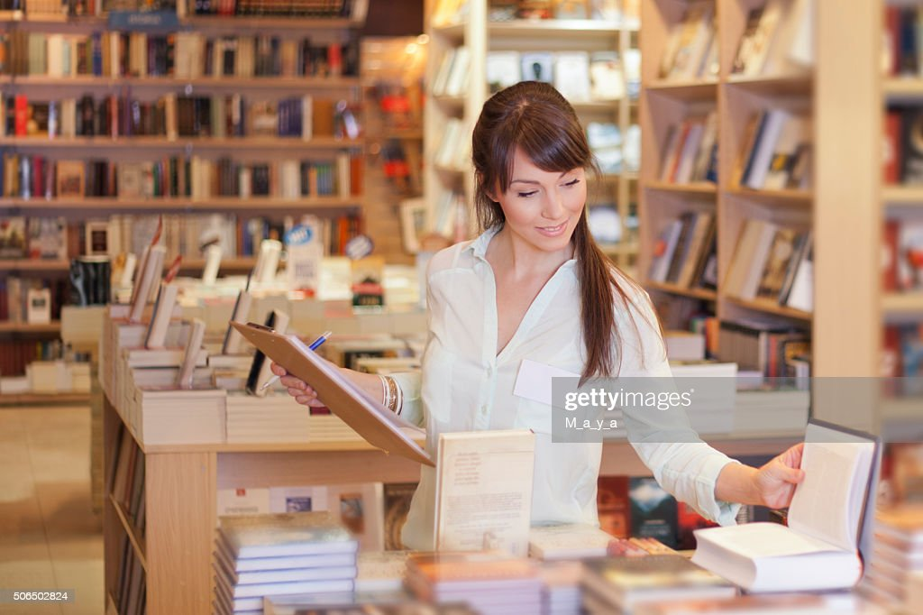 Women working at bookstore : Stock Photo