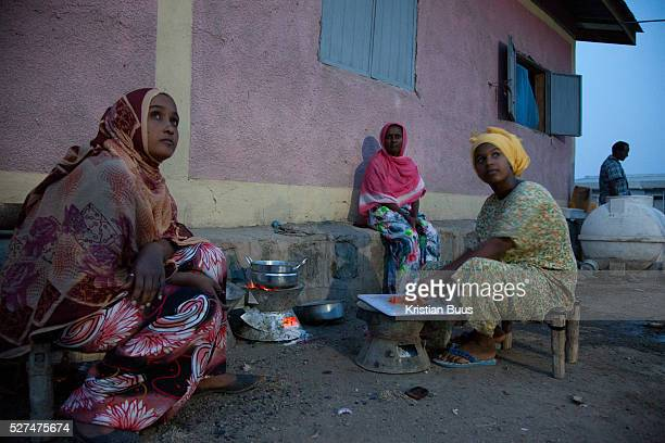 Women working for the local ngo AISDA cook dinner a meat sauce and spagetti over an open fire The ngo is based in Delafagi and work under minimal...