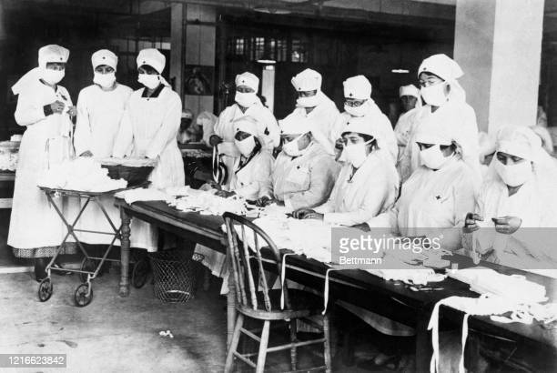 Women working for the Red Cross make masks during the pandemic flu in 1918