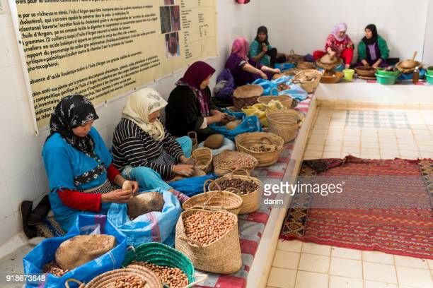 women working in a cooperative for the manufacturing of argan fruits