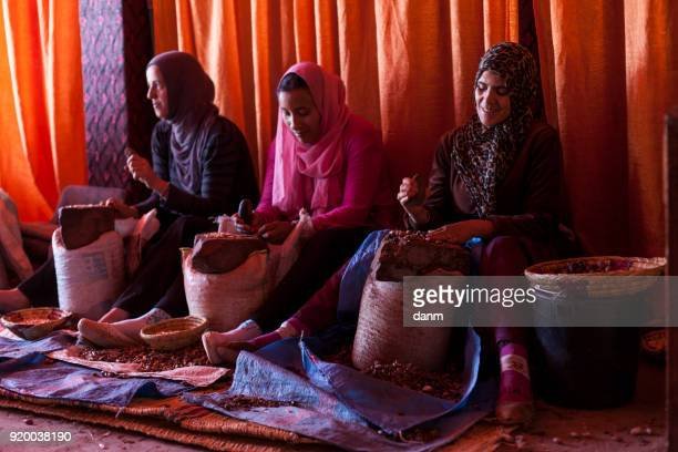 women working in a cooperative for the manufacturing of argan fruits in Atlas Mountain