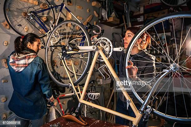 Women working in a garage