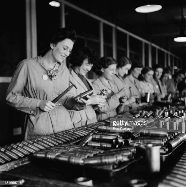Women working in a munitions factory in Birmingham England during World War II August 1941 From a Ministry of Information special on Birmingham