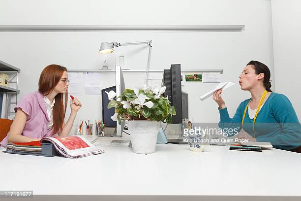 women working in an office - wasting time stock pictures, royalty-free photos & images