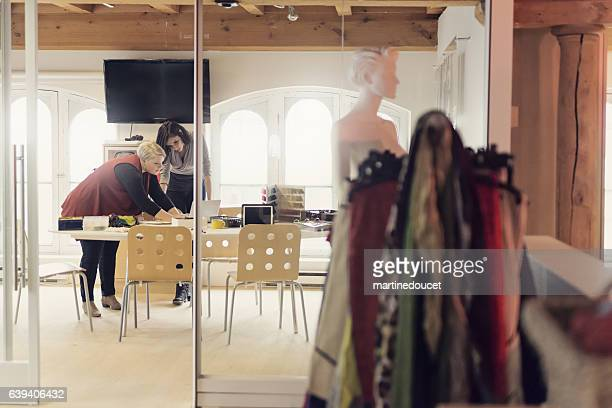 Women working in small creative fashion enterprise.