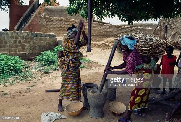 Women working millet in the Bambara village of Segoukoro near Segou Mali