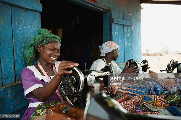 women working on a sewing machine