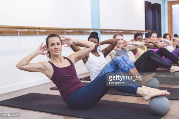 Women Working Out Together at Modern Gym