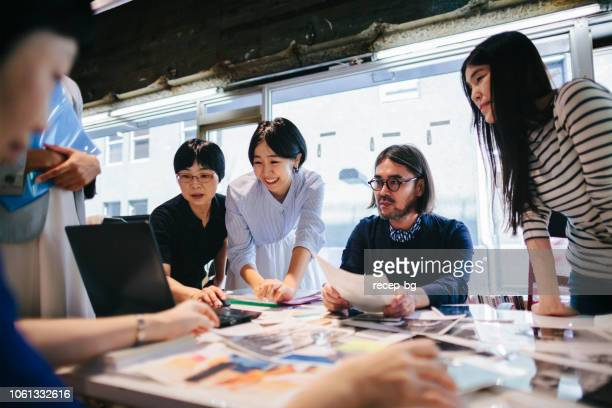 women working together in modern working space - japan stock pictures, royalty-free photos & images