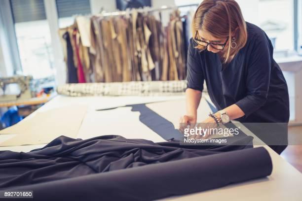 Women Working Together. Mature female designer is working in her workshop
