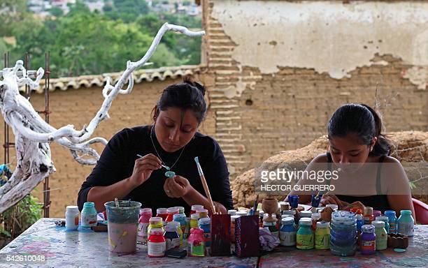 Women works on Alebrijes in a crafts workshop in San Antonio Arrazola Oaxaca State Mexico on 22 June 2016 Alebrijes are coloured Mexican folk art...