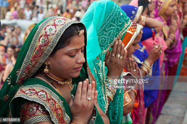 CONTENT] Women worshiping Hindu gods Shiva and Parvati at the Gangaur and Mewar festival held in Udaipur in march 2010 Rajasthan India Gangaur is a...