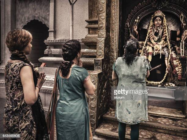 Women worshipping Goddess Kali in Little India Singapore