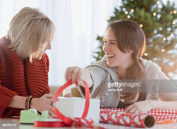 Women wrapping Christmas gifts