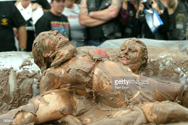 Women wrestle in a ring of pudding at the 10th Annual Pudding Wrestling at the No Name Saloon March 7 2003 in Edgewater Florida During Bike Week the...