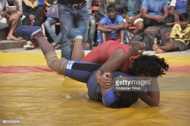 Women wrestlers Freedom Yadav and Bhavana wrestling during Women Wrestling competition at Assi Ghat on November 28 2017 in Varanasi India
