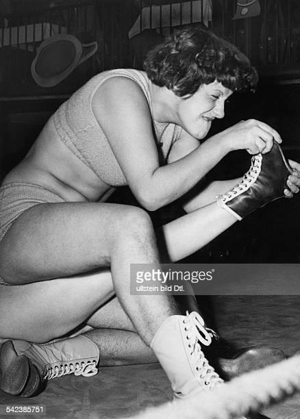 women wrestling match at 'Palais de Danse' Berlin here 'The Black Panther' Ellen Loeschmann fighting against her rival