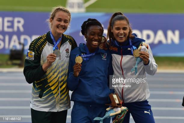 Women's 400 m Hurdles Final podium with Zeney Van Der Walt of South Africa silver medal Ayomide Folorunso of Italy gold medal and Amalie Iuel of...