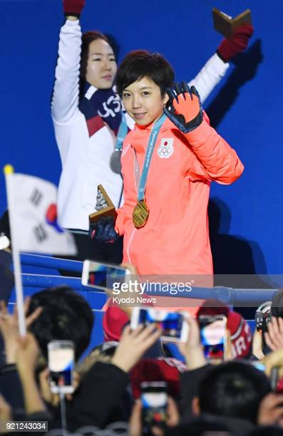 Women's 500meter speed skating gold medalist Nao Kodaira of Japan and silver medalist Lee Sang Hwa of South Korea attend the medal ceremony at the...