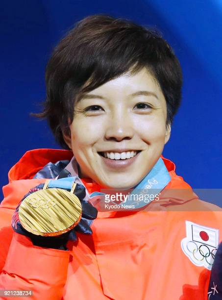Women's 500-meter speed skating gold medalist Nao Kodaira of Japan poses at the medal ceremony at the Pyeongchang Winter Olympics in South Korea on...