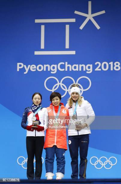 Women's 500meter speed skating gold medalist Nao Kodaira of Japan silver medalist Lee Sang Hwa of South Korea and bronze medalist Karolina Erbanova...